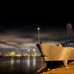HMS Daring is seen here alongside the berth on Coronado Island, with the San Diego City skyline in the background.  HMS Daring visited San Diego, California between the 25th June to the 1st July 2013. The aim of the visit was to take an opportunity to show off HMS Daring and provide a state of the art platform for both industry and military engagement whilst in San Diego.  HMS Daring is currently deployed for nine months to demonstrate the Royal Navy's global reach which includes contributing to maritime security in the Asia Pacific, conducting science and technology trials in the Pacific and representing the UK in Exercise Bersama Lima. This is part of the Five Power Defence Arrangement annual programme of exercises in the region where she will be operating with ships from the Navies of Australia, New Zealand, Malaysia and Singapore.  The deployment will also allow Daring and her 190 crew to represent the UK at high-profile celebrations to mark the 100th anniversary of the Royal Australian Navy.  Daring will also conduct a series of worldwide port visits to engage in wider regional Defence Engagement.