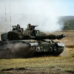 Pictured is a Challenger 2 Main Battle Tank taking part in Exercise VENRABLE GAUNTLET.  Over 3000 personnel from 14 NATO countries took part in the UK's national validation exercise for the NATO Very High Readiness Joint Task Force (Land) 2017 (VJTF(L)17).  Each of the 14 troop contributing nations in attendance had elements of the personnel and equipment they would deploy with the VJTF(L). This allows the NATO partners to test and demonstrate their interoperability and the unique capabilities they provide.  Artillery from Force Troop Command operated with Spanish artillery demonstrating their ability to fire on targets identified and co-ordinated by British and Norwegian reconnaissance patrols.  British, Danish and Polish infantry worked together to ensure that the Armoured, Mechanised and Light Role Battle Groups could communicate and operate together, supported by a multinational engineer group, reconnaissance patrols and attack helicopters.  The Very High Readiness Joint Task Force (VJTF) consists of around 20,000 personnel and includes Land, Air, Maritime and Special Forces components. The Land Component is known as the Very High Readiness Joint Task Force (Land) (VJTF(L)).  The VJTF is part of NATO's enhanced NATO Response Force (eNRF) which was agreed at the 2014 Wales NATO Summit when allies decided to enhance the previous NRF to strengthen the Alliance's collective defence and ensure that NATO has the right forces in the right place at the right time.